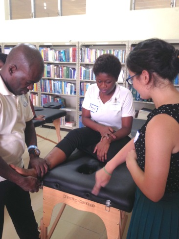 Merly seated on PT table, library-Musculoskeletal 1 (1)
